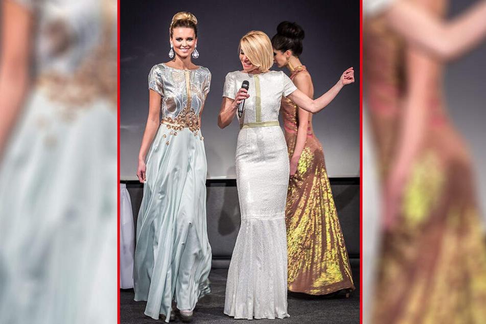 """Model Katja Kühne (33) führt bei einer """"Weißen Nacht"""" auf Schloss Wackerbarth ein Kleid aus der """"Zingarelli""""-Kollektion vor."""