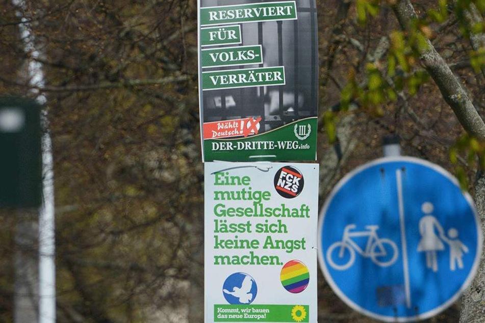"""Die Europawahlplakate der rechtsextremen Partei """"Der III. Weg"""" sorgen in Chemnitz für Aufruhr - direkt darunter der krasse Kontrast: Ein Wahlplakat der Grünen."""