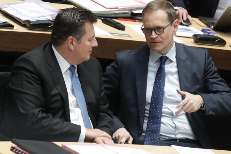 Andreas Geisel (l.) mit Berlins Bürgermeister Michael Müller (r.).