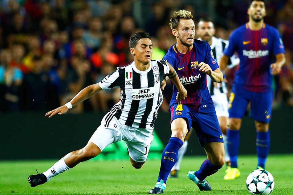 Ivan Rakitic (vorne-rechts) ist seit vier Jahren ein prägender Spieler beim FC Barcelona.