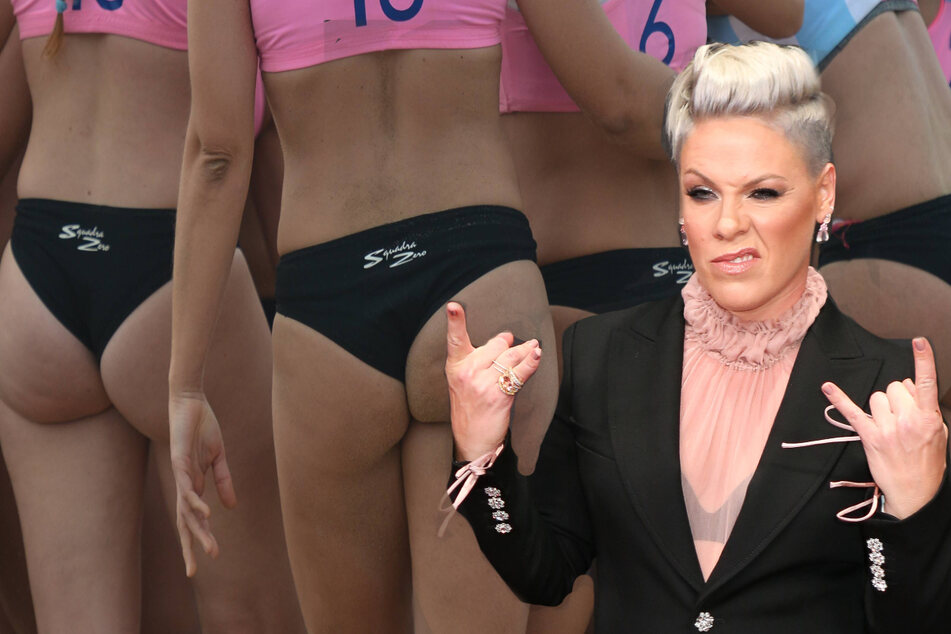 """Pink wants to pay the Norwegian women's beach handball team's fine for """"inappropriate clothing."""""""