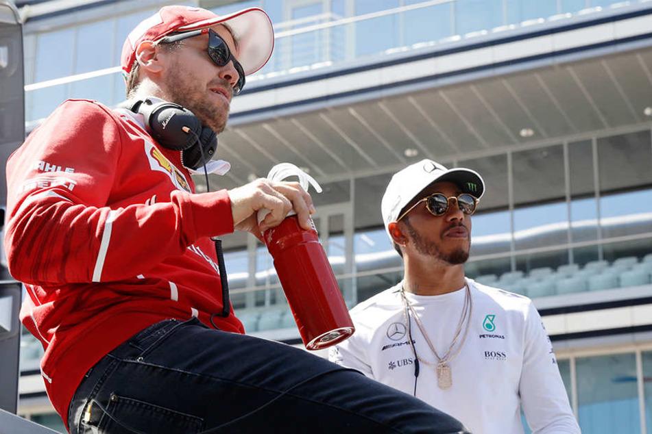 Im WM-Kampf mit Vettel (l.) hat Hamilton die Nase vorn.
