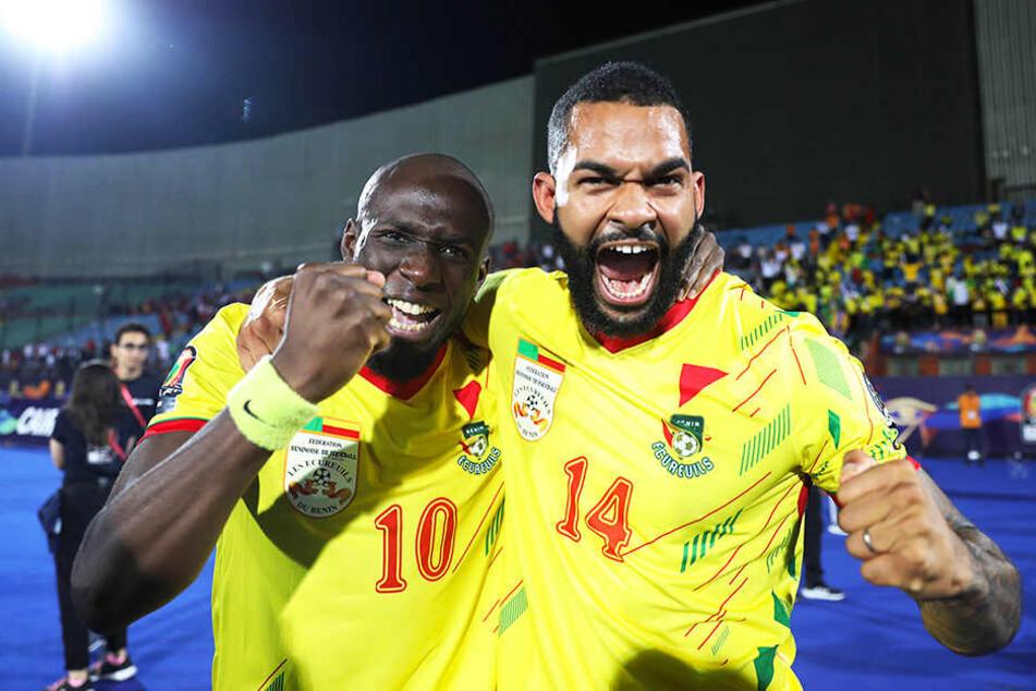 Freudentaumel: Mickaël Poté (l.) und Cebio Soukou nach dem hart erkämpften Sieg mit dem Benin gegen Marokko.