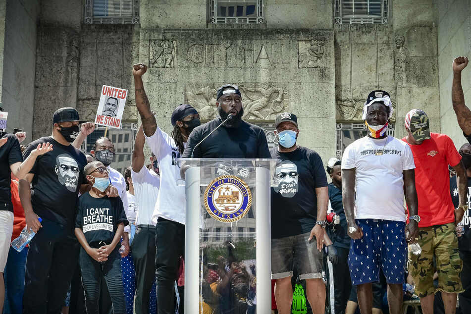 Trae the Truth (c.) speaks outside Houston City Hall during a protest in honor of George Floyd.