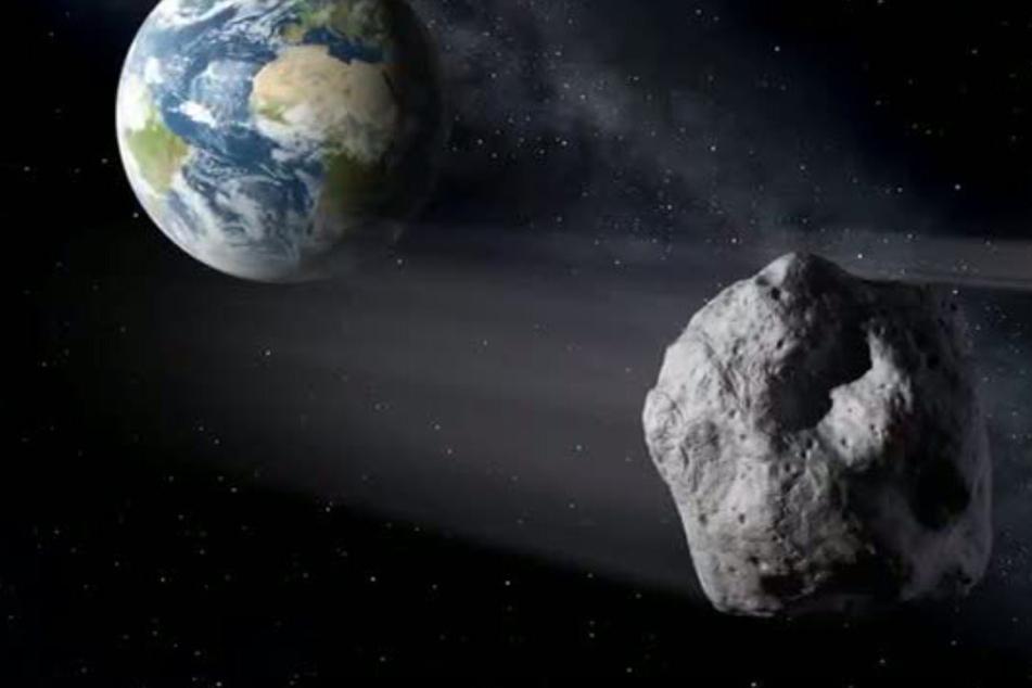 """Die grafische Darstellung zeigt einen Asteroiden (re.) beim Vorbeiflug an der Erde. Asteroiden rasen sehr häufig an der Erde vorbei - meist aber in recht großem Abstand. Näher kommt unserem Planeten Anfang September der Asteroid """"2011 ES4""""."""