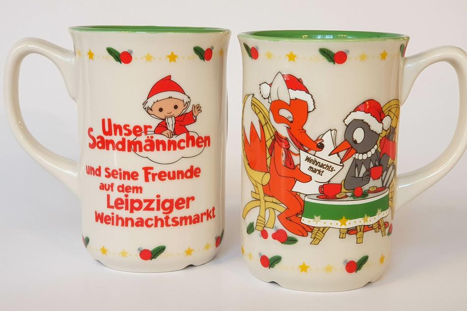 Das diesjährige Kindertassen-Motiv: Fuchs und Elster feiern Weihnachten.