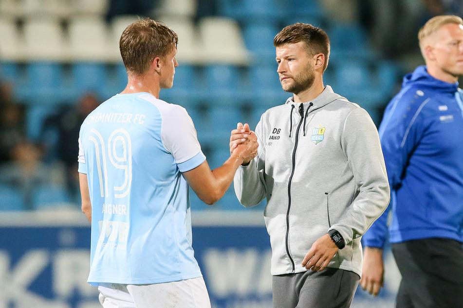 Lukas Aigner (l.) mit Trainer Daniel Berlinski.
