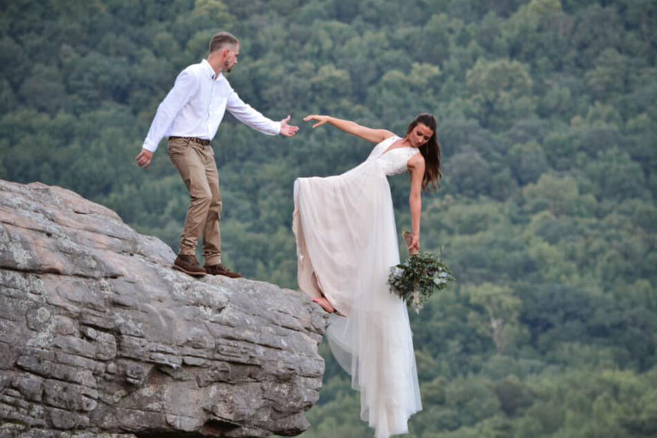 Is the bride about to fall off? Her bulging dress hides the secret to her safety.