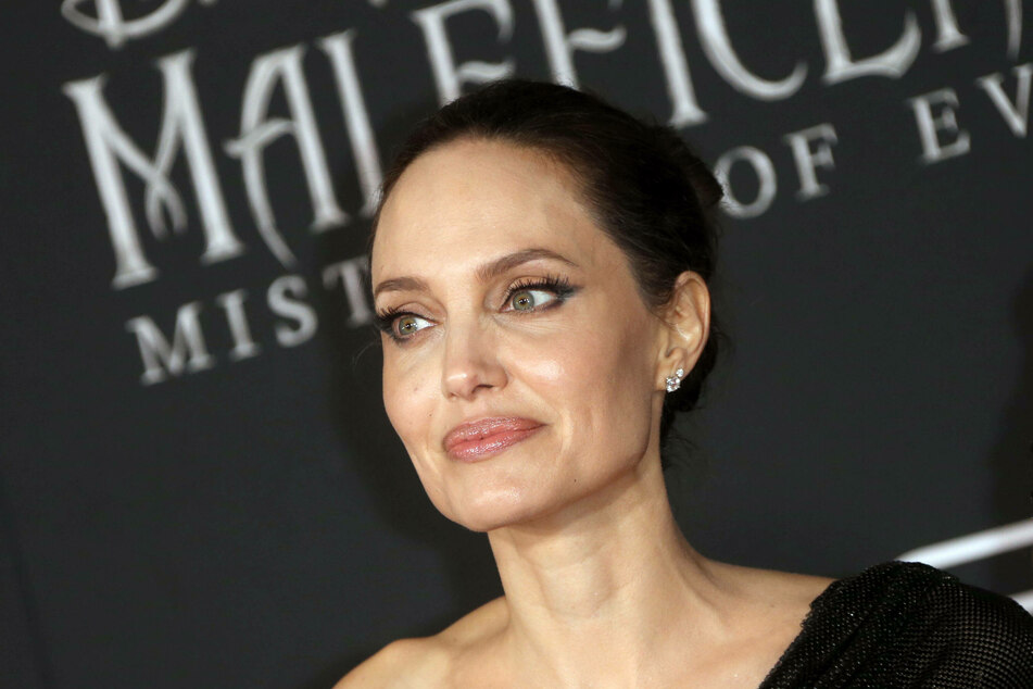 Angelina jolie is supposedly not a fan of her ex- husband's new relationship.