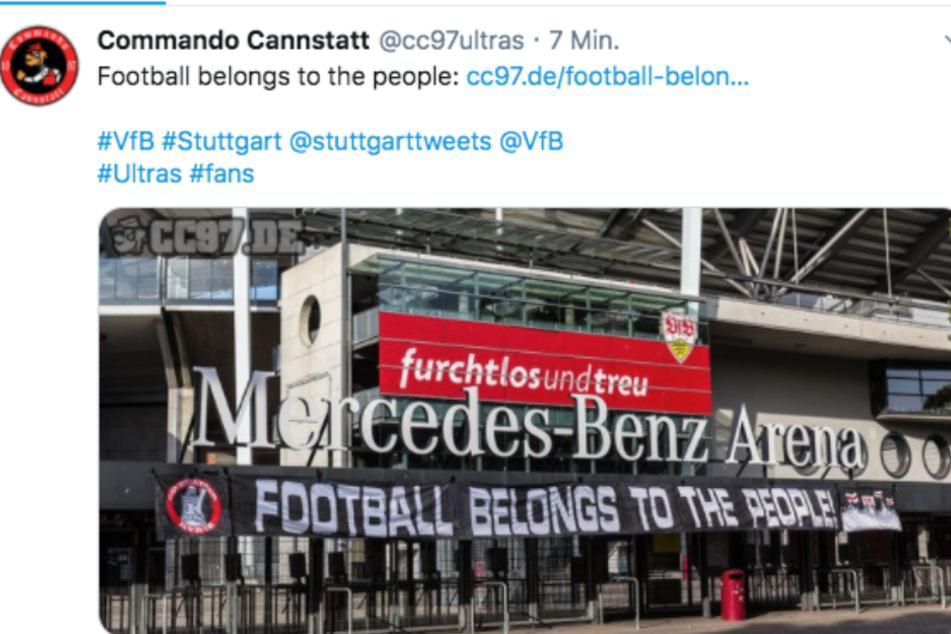 """Das """"Commando Cannstatt"""" hisst ein Banner vor der Mercedes-Benz Arena."""