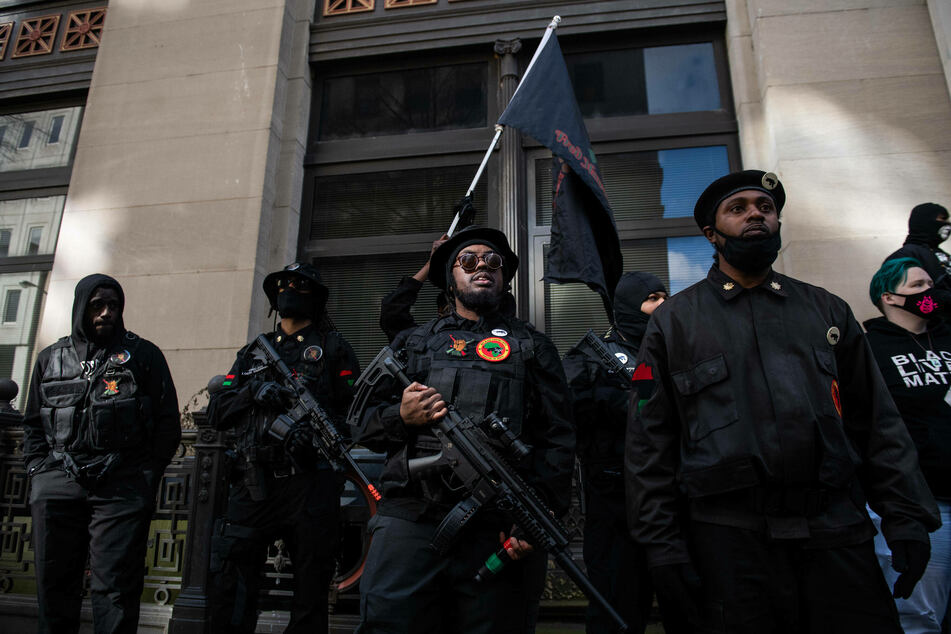 Members of the New Black Panther Party joined the protest.