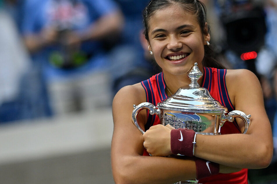 Emma Raducanu hugs the US Open trophy after her historic win.