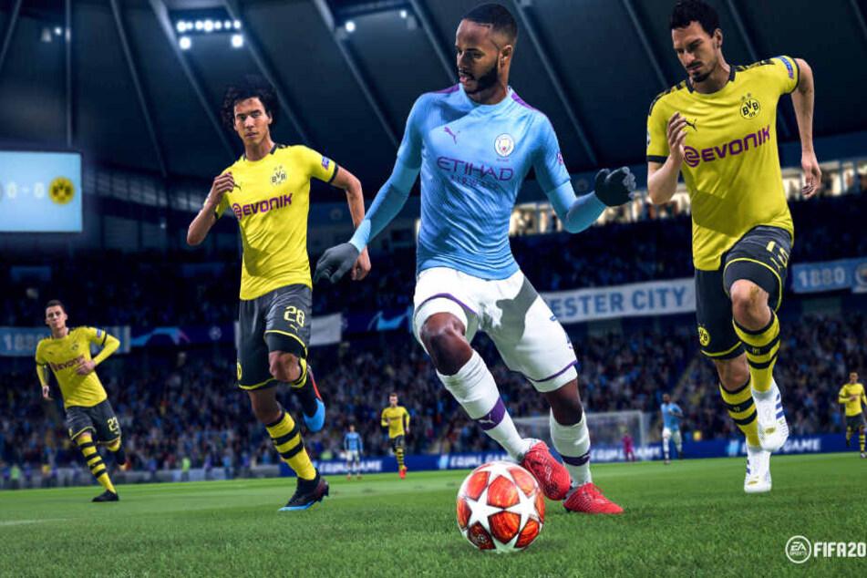 Manchester Citys Raheem Sterling (am Ball) im Laufduell mit den BVB-Spielern Axel Witsel (links) und Mats Hummels.