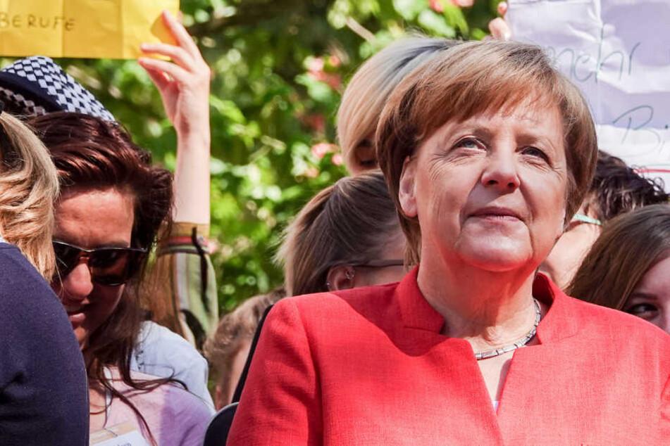In Münster hat Kanzlerin Angela Merkel ein volles Programm.