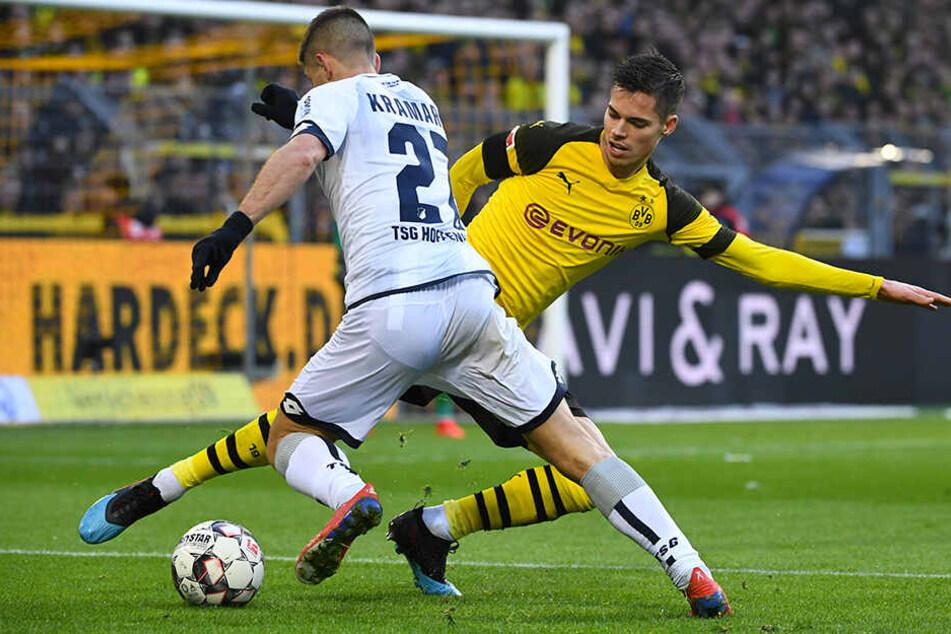 Machte lange Zeit ein überragendes Spiel: Dortmunds Julian Weigl (r.) räumte hinten viel ab. Hier stoppt er den Lauf von TSG-Stürmer Andrej Kramaric (l.).