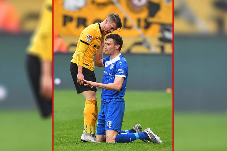 """""""Was soll das?"""" oder wenn Blicke töten könnten: Aus Sorge um seine Gesundheit war Dynamos Patrick Möschl (l.) stinksauer auf Magdeburgs Charles-Elie Laprevotte ..."""