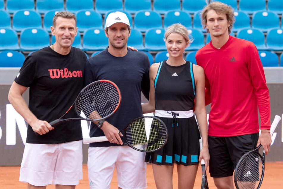 Patrik Kühnen (l-r), Turnierdirektor, Mischa Zverev, Tennisspieler, Lena Gercke, Model und Moderatorin, und Alexander Zverev, Tennisspieler, bei der Eröffnung des Turniers in München.