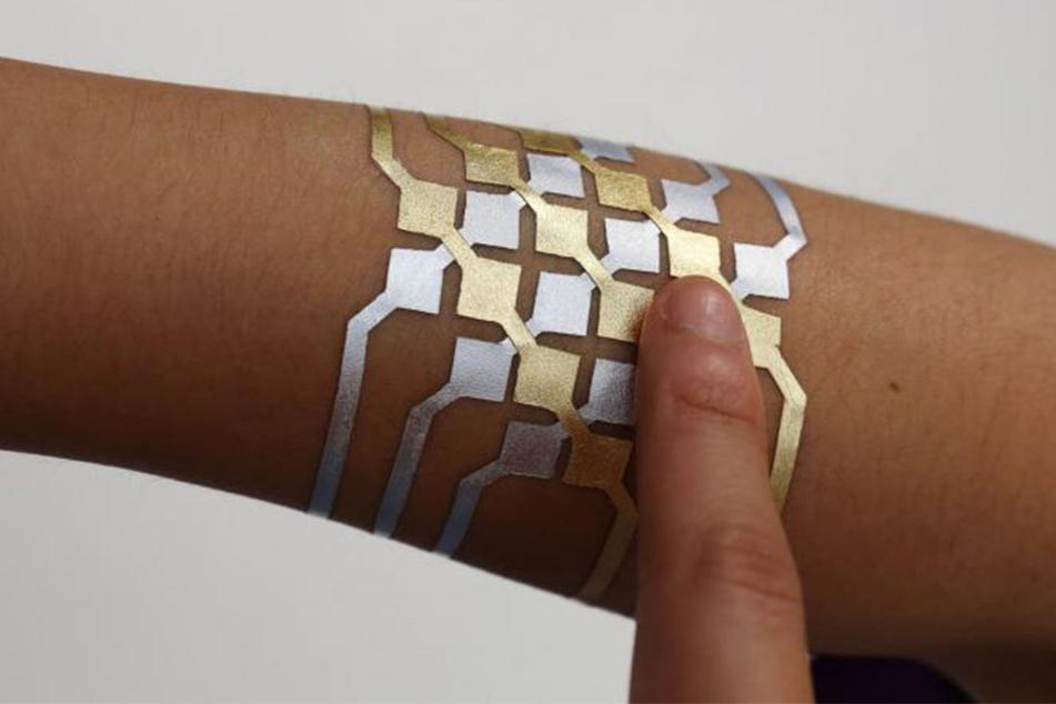 Smart Tattoos sollen eine günstige Alternative zu Smartwatch und Co. werden.