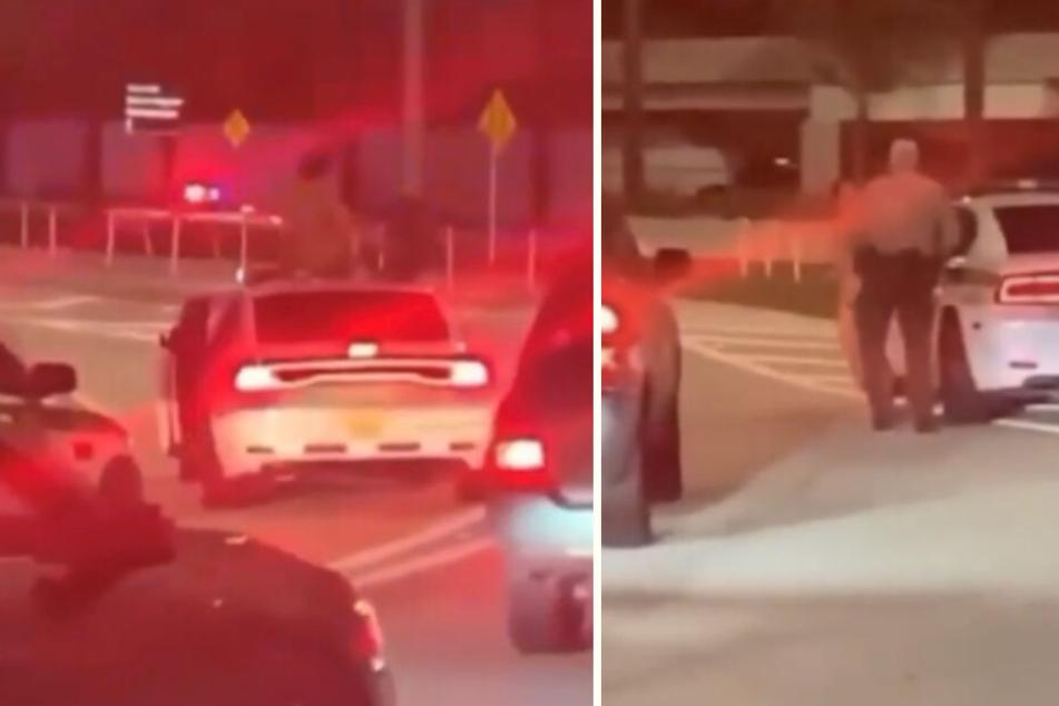Vor dem Flughafen saß die Frau zunächst auf einem Auto, bevor die Polizei sie festnahm.