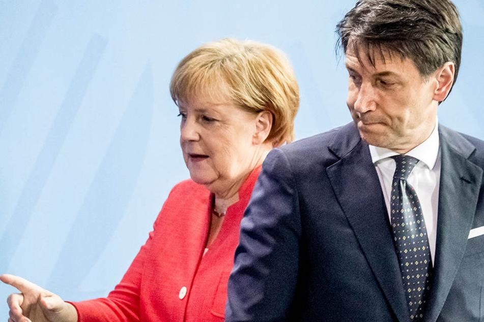 Bundeskanzlerin Angela Merkel (CDU) beißt sich gerade an Giuseppe Conte, Ministerpräsident von Italien, die Zähne aus.