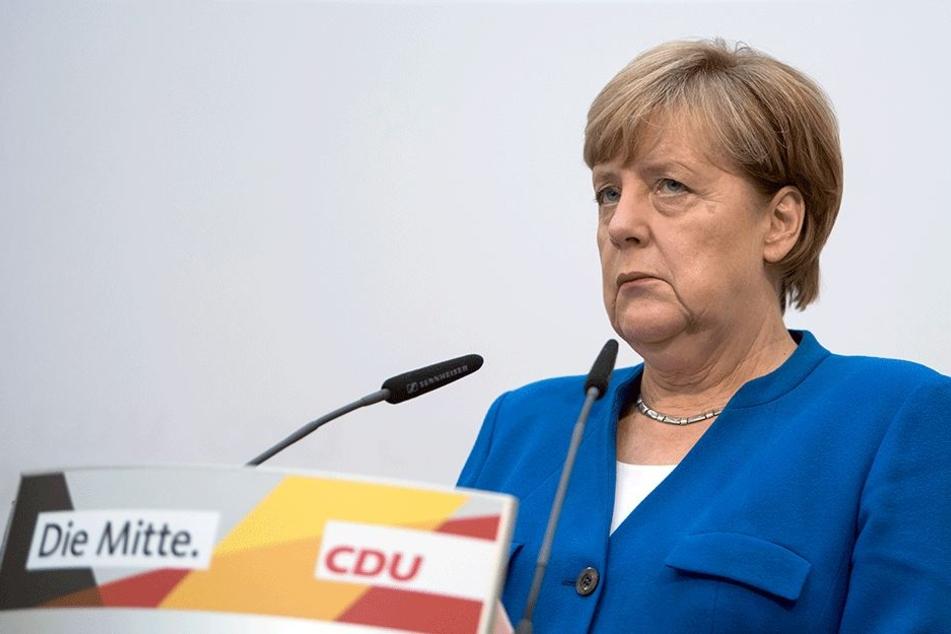 CDU-Mitglieder fordern nach Wahlschlappe Merkels Rücktritt