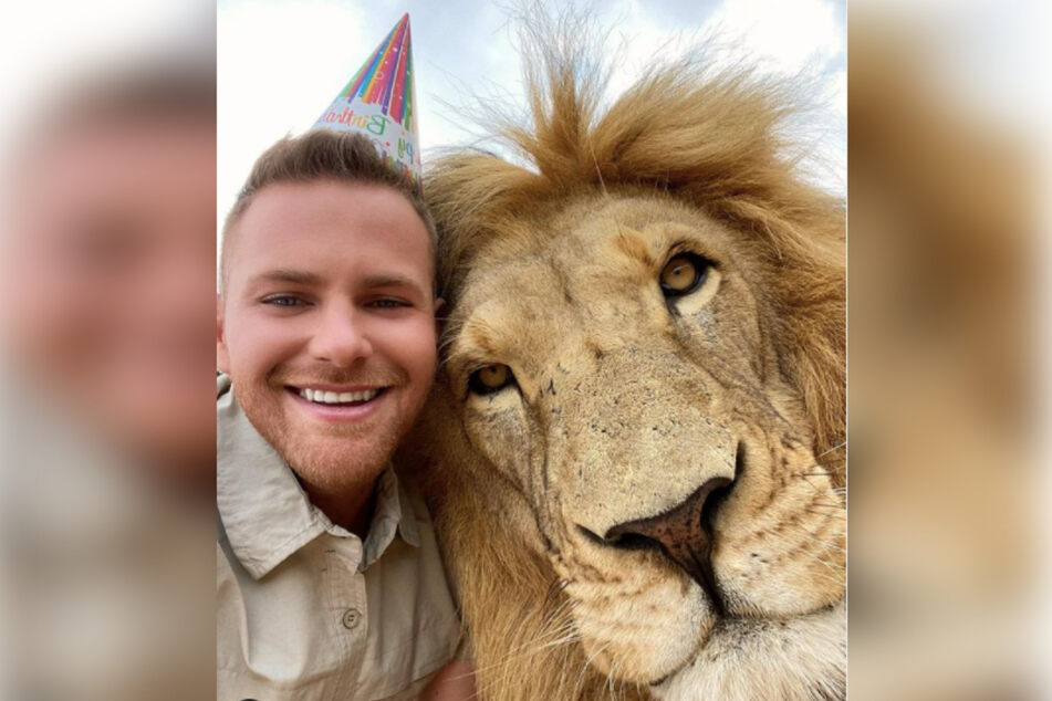 The lion tamer celebrated his 26th birthday with his best friend George the lion.