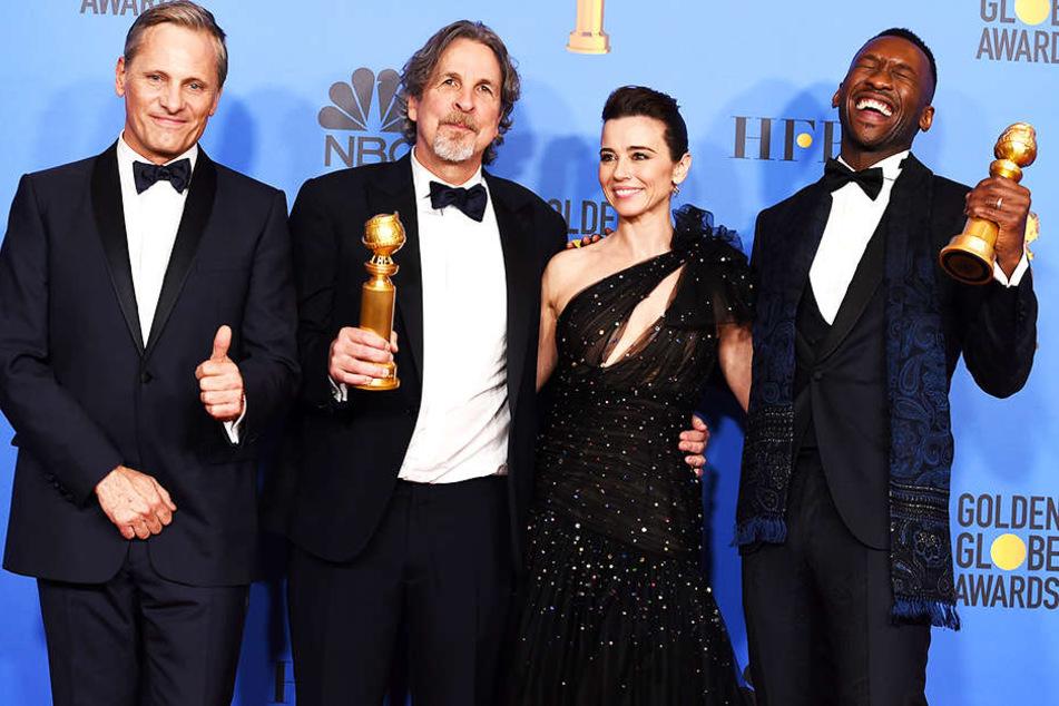 """Kein Film bekam mehr Awards: """"Green Book"""" räumte drei Trophäen ab. Hier freuen sich von links nach rechts Hauptdarsteller Viggo Mortensen, Regisseur Peter Farrelly, Nebendarstellerin Linda Cardellini und Nebendarsteller Mahershala Ali."""