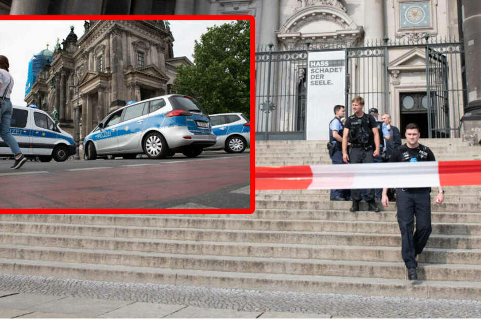 Beamte sichern den Dom ab. (Bildmontage)