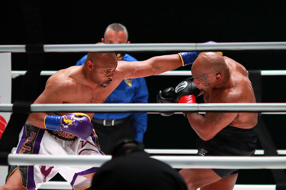 Roy Jones Jr. throws a punch in the second round against Mike Tyson during their exhibition bout.