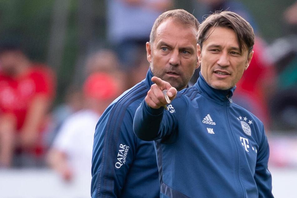 Bundesligist FC Bayern München hat sich von Trainer Niko Kovac (r.) getrennt. Co-Trainer Hansi Flick (l.) springt auf Zeit ein.