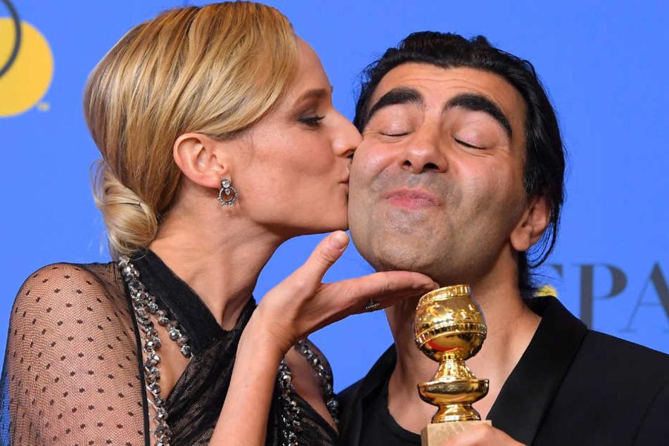 """Bei den 75. Golden Globe Awards gewann Fatih Akins (rechts) Film """"Aus dem Nichts"""" in der Kategorie bester nicht-englischsprachiger Film. Schauspielerin Diane Kruger gratuliert dem Preisträger."""