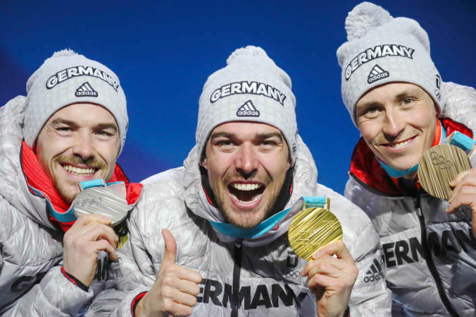 Fabian Rießle (v.l.), Johannes Rydzek und Eric Frenzel wollen heute in Pyeongchang im Staffelrennen das goldene Olympia-Triple perfektmachen.