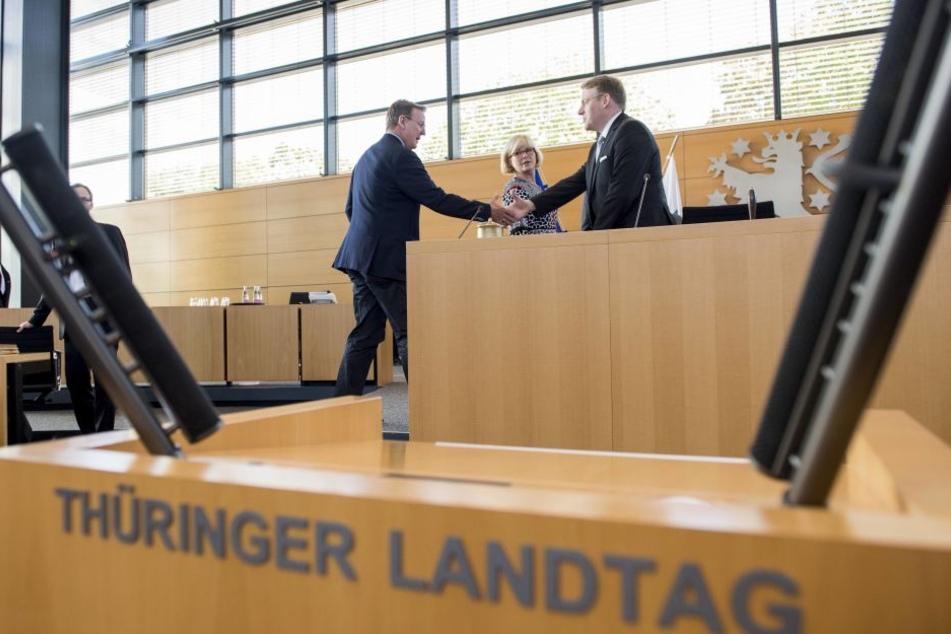 Landtagspräsident Christian Carius (r.,CDU)