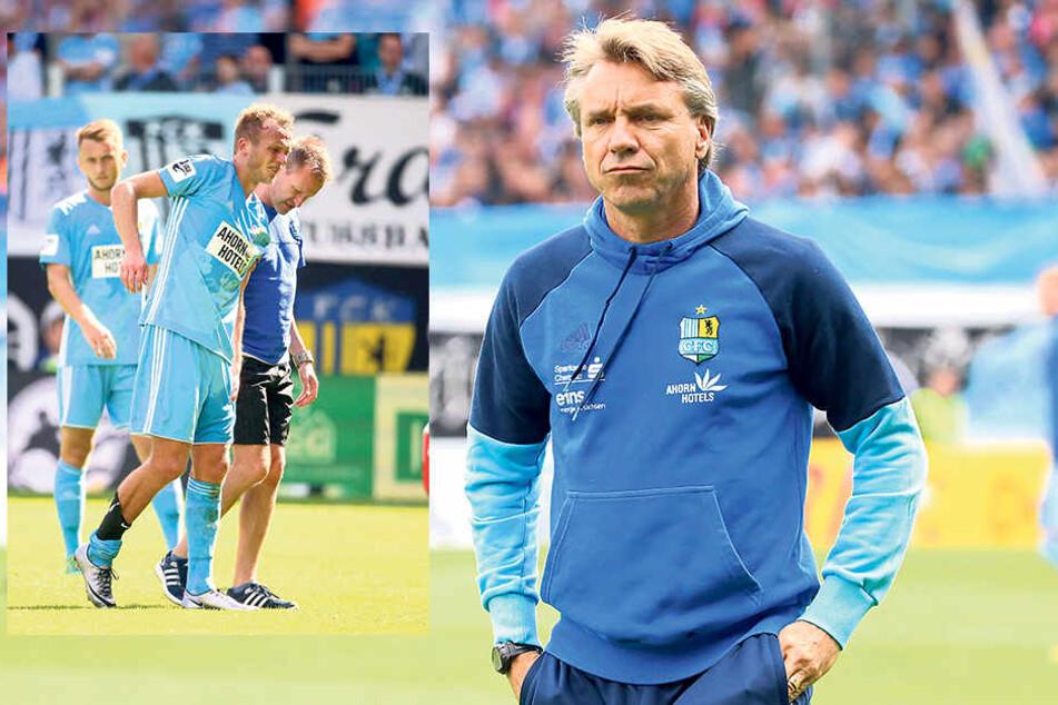 Mit schmerzverzerrtem Gesicht wird Julius Reinhardt von Mannschaftsarzt Dirk Harlos vom Platz geführt. (kl.F.) Horst Steffen 8re.) hat ein echtes Problem.