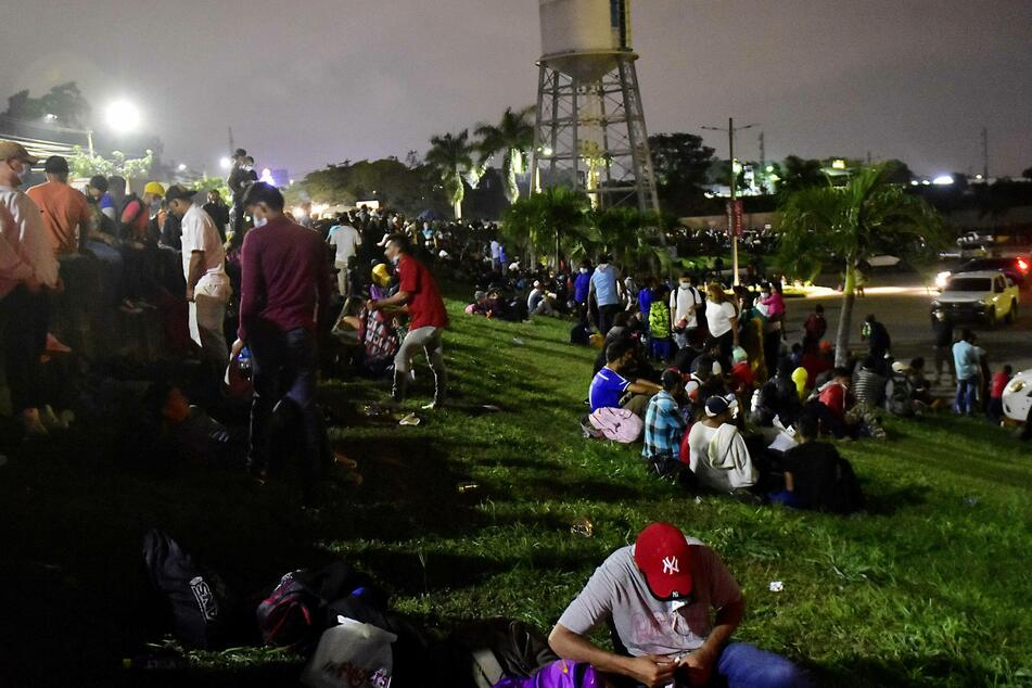 A group of hundreds of Hondurans rest as they prepare to leave in a new migrant caravan at the Gran Central Metropolitana in San Pedro Sula.