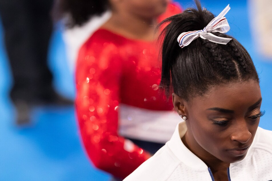 Simone Biles withdraws from floor exercise as last Olympic event hangs in the balance