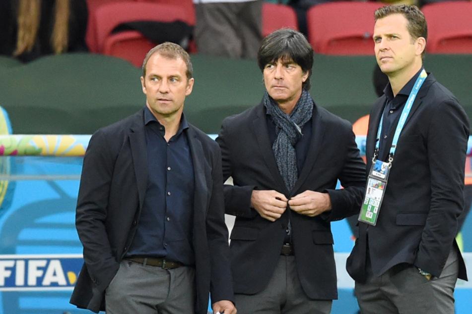 Hansi Flick (56, l.-r.), Joachim Löw (61) und Oliver Bierhoff (52) bei der WM 2014 in Brasilien.