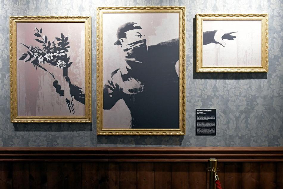 """Eine Variation des wütenden Banksy-Bildes """"Der Blumenwerfer"""" (2003 in Israel entstanden)."""