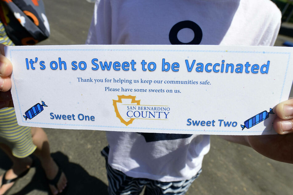 All who received a shot of the Johnson & Johnson Covid-19 vaccine at Nunez Park in San Bernardino on Saturday received their choice of a churro or shaved ice treat.