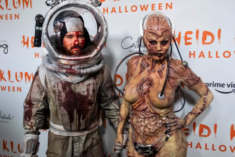 In 2019 Heidi (47) was dressed up as zombie and Tom (31) as a bloodied spacemen.