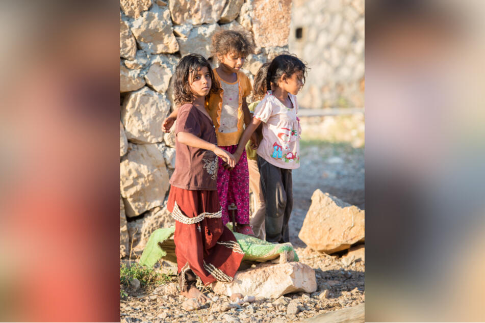 Unknown Yemeni girls were seen playing on the edge of a street on the island of Socotra.