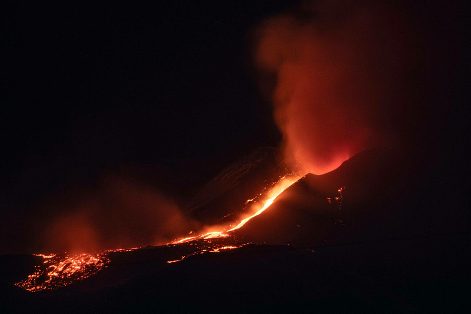 Lava flows down the crater of Mount Etna after an eruption.