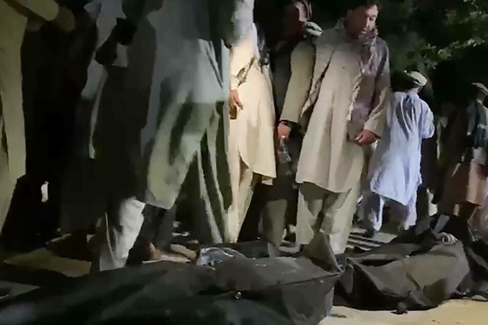 Victims bodies wrapped in bags after the August 26 twin suicide bomb attack near Kabul airport.