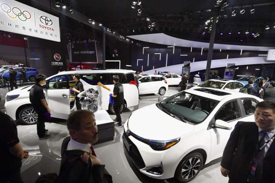 Deutsche Autohersteller nutzen die Autoshow in Guangzhou, um ihre Elektro-Autos vorzustellen. Der Markt scheint hier fruchtbarer, als in Deutschland zu sein.