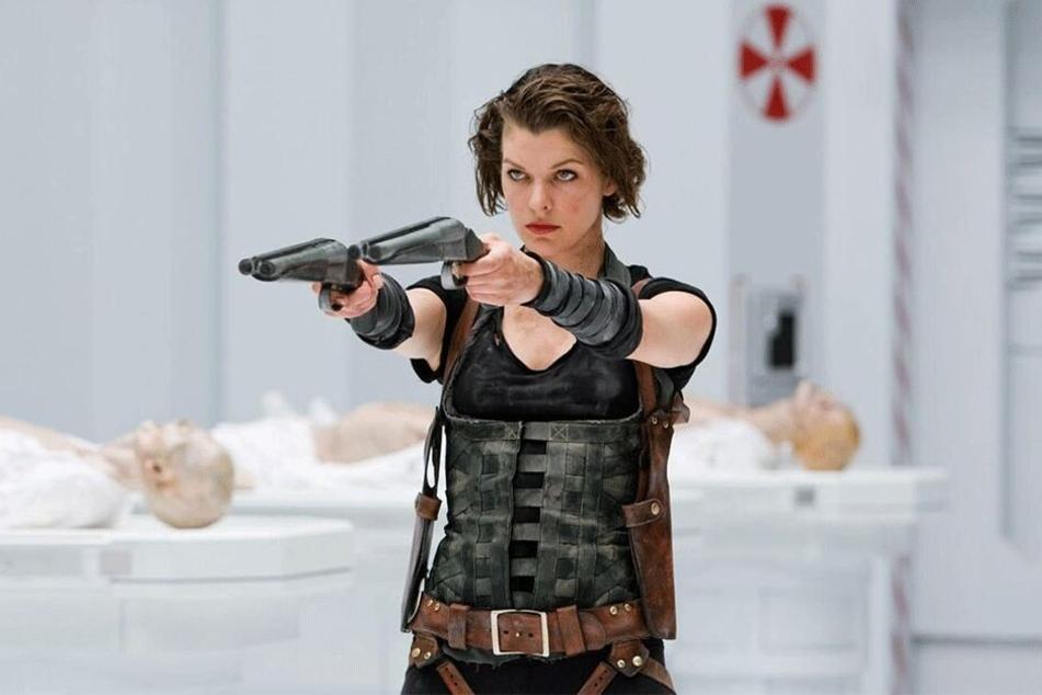 """In den """"Resident Evil""""-Filmen muss Alice (Milla Jovovich) die Bedrohung rund um den gefährlichen T-Virus der Umbrella Corporation abwehren."""