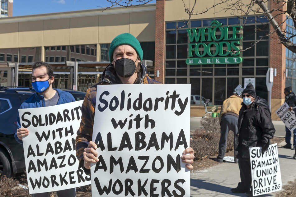 Picketers supporting the Alabama unionization drive marched in front of Amazon Whole Foods market in Detroit. Whole Foods is owned by Amazon.