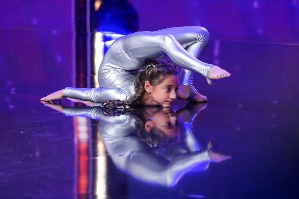 Die achtjährige Keisi will mit ihren akrobatischen Künsten überzeugen.
