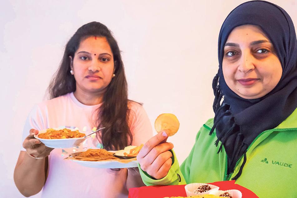Fleißige Köchinnen: Marwa Shamat (36, rechts) aus Syrien und Jigisha Makrama  (33,l.) aus Indien präsentieren landestypischen Speisen.
