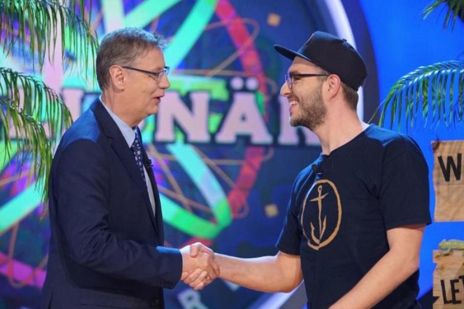 Tim Michatz schüttelt Günther Jauch die Hand. Stolz berichtete er davon, wie er George Clooney begegnete.
