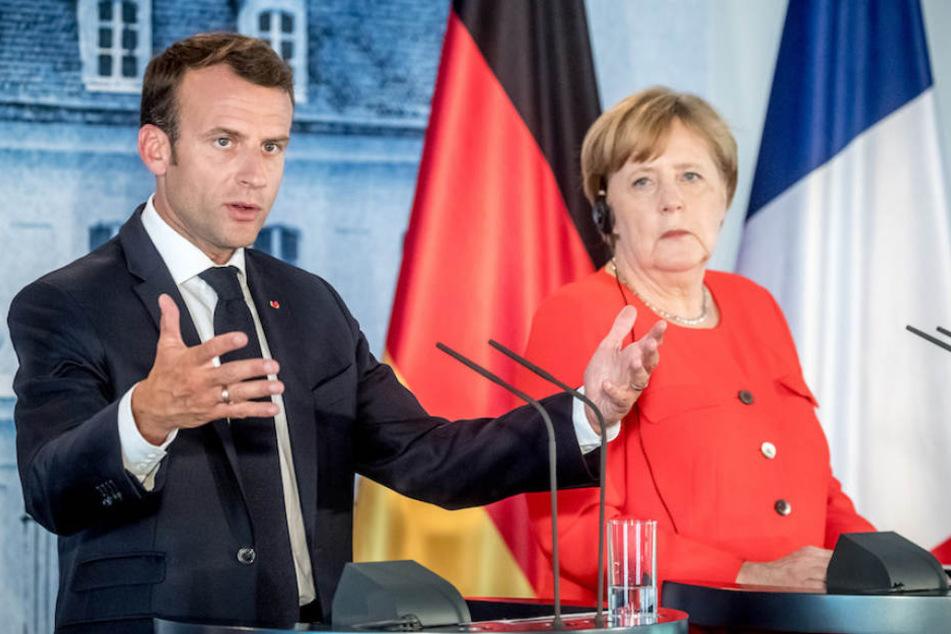 So wollen Merkel und Macron Facebook und Google ans Geld